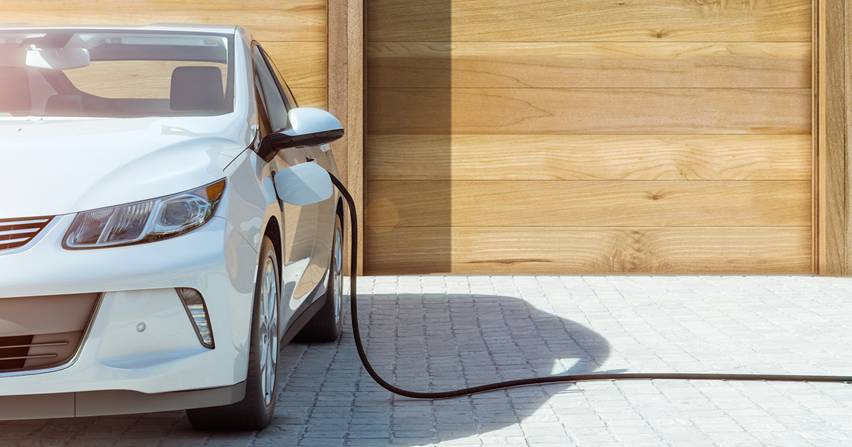 EV charger hooked up to electric vehicle