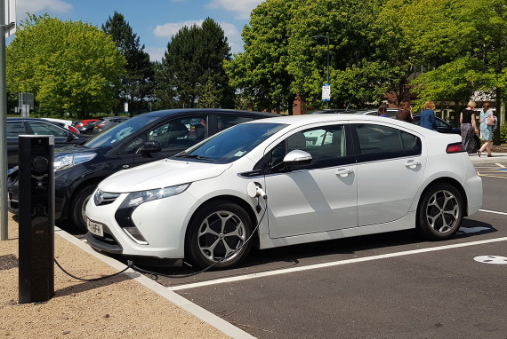Charging electric vehicle at a school